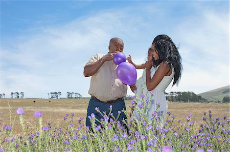 Family playing with balloons in field Stock Photo - Premium Royalty-Free, Code: 649-06488466