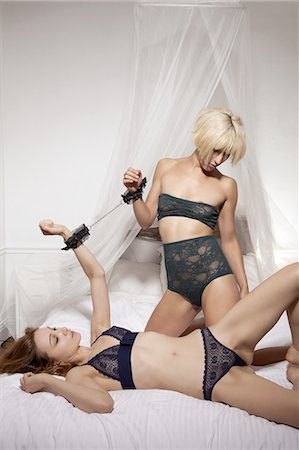 Women in lingerie in bed together Stock Photo - Premium Royalty-Free, Code: 649-06488599