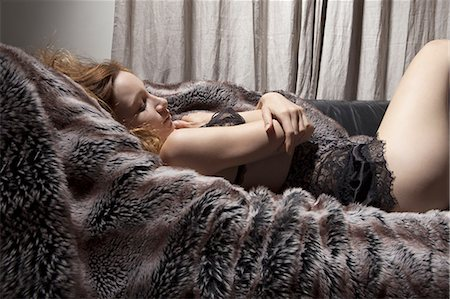 fur - Woman in lingerie laying on fur blanket Stock Photo - Premium Royalty-Free, Code: 649-06488593