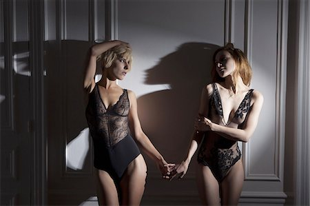 Women in lingerie holding hands Stock Photo - Premium Royalty-Free, Code: 649-06488602