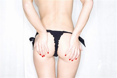 Woman in underwear holding buttocks Stock Photo - Premium Royalty-Free, Code: 649-06488615