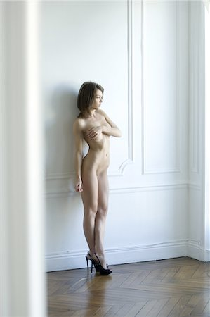 Nude woman leaning against wall Stock Photo - Premium Royalty-Free, Code: 649-06488619