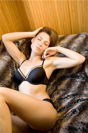 sexy - Woman in lingerie laying on blanket Stock Photo - Premium Royalty-Free, Code: 649-06488611