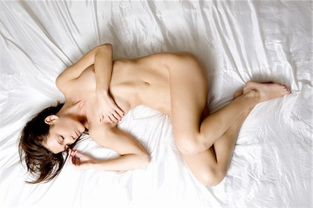 Nude woman laying on bed Stock Photo - Premium Royalty-Free, Code: 649-06488624