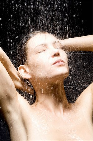 Woman rinsing her hair in shower Stock Photo - Premium Royalty-Free, Code: 649-06488628