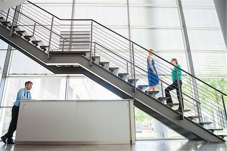 Business people walking in office Stock Photo - Premium Royalty-Free, Code: 649-06488674
