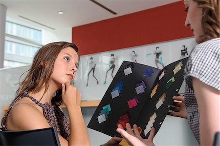 Businesswomen examining fabric swatches Stock Photo - Premium Royalty-Free, Code: 649-06488696