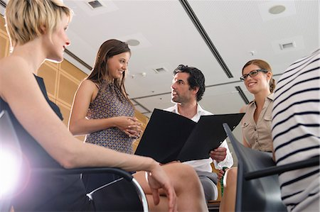 Business people talking in office Stock Photo - Premium Royalty-Free, Code: 649-06488706