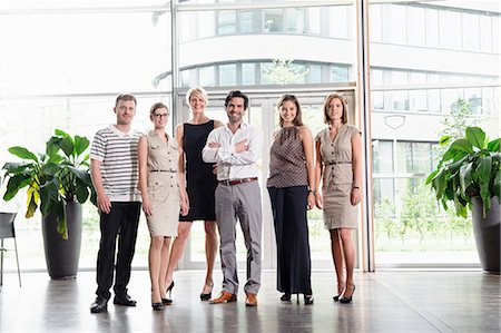 Business people smiling in office Stock Photo - Premium Royalty-Free, Code: 649-06488710