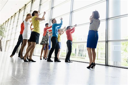 fitness   mature woman - Business people dancing in office Stock Photo - Premium Royalty-Free, Code: 649-06488713