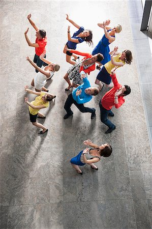 Overhead view of people dancing Stock Photo - Premium Royalty-Free, Code: 649-06488724