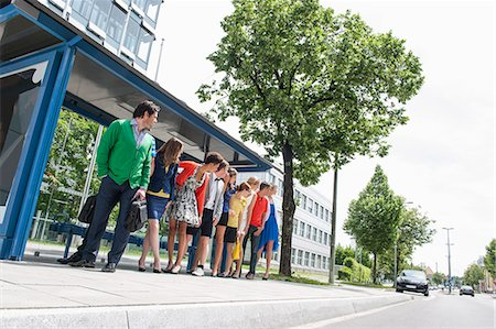 People waiting at bus stops Stock Photo - Premium Royalty-Free, Code: 649-06488733