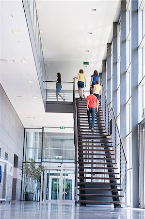 Business people climbing office stairs Stock Photo - Premium Royalty-Free, Code: 649-06488742