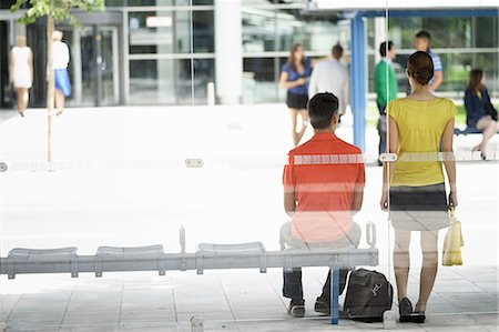 People waiting at bus stop Stock Photo - Premium Royalty-Free, Code: 649-06488766