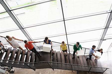 People passing boxes up stairs Stock Photo - Premium Royalty-Free, Code: 649-06488773