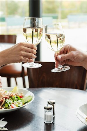 Couple toasting each other at cafe Stock Photo - Premium Royalty-Free, Code: 649-06488888