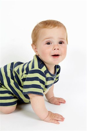Toddler boy crawling on floor Stock Photo - Premium Royalty-Free, Code: 649-06488928