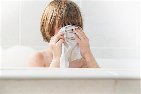 Girl washing her face in bath Stock Photo - Premium Royalty-Free, Code: 649-06489041