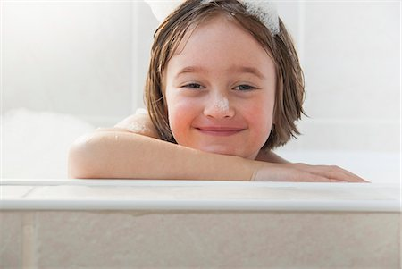 Smiling girl siting in bath Stock Photo - Premium Royalty-Free, Code: 649-06489042