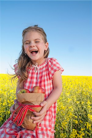 Girl holding sack of apples outdoors Stock Photo - Premium Royalty-Free, Code: 649-06489069