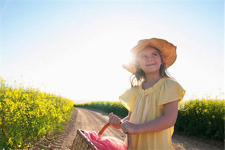 portrait looking away - Girl carrying basket on dirt road Stock Photo - Premium Royalty-Free, Code: 649-06489073