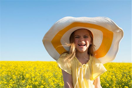 Girl wearing sun hat outdoors Stock Photo - Premium Royalty-Free, Code: 649-06489081