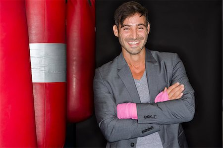 Smiling boxer standing in gym Stock Photo - Premium Royalty-Free, Code: 649-06489194