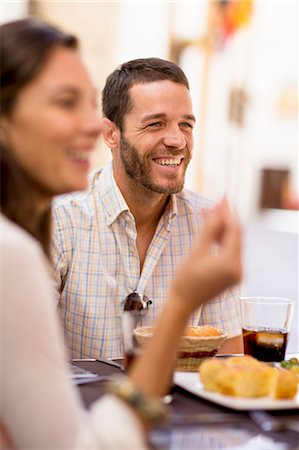 Friends talking at dinner Stock Photo - Premium Royalty-Free, Code: 649-06489213