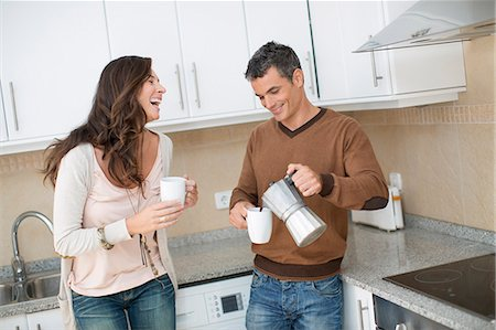 pouring - Couple having coffee in kitchen Stock Photo - Premium Royalty-Free, Code: 649-06489224