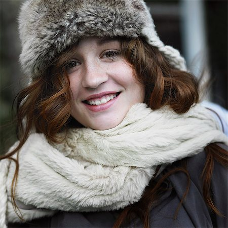 preteen beauty - Smiling woman wearing hat and scarf Stock Photo - Premium Royalty-Free, Code: 649-06489294