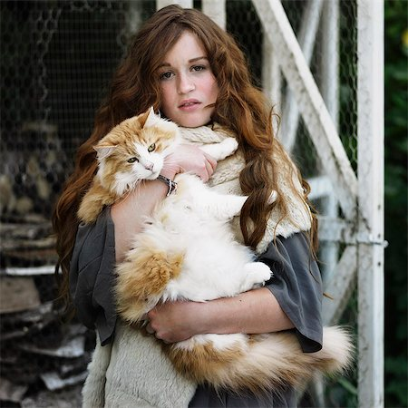 preteen girl pussy - Woman holding large cat outdoors Stock Photo - Premium Royalty-Free, Code: 649-06489293
