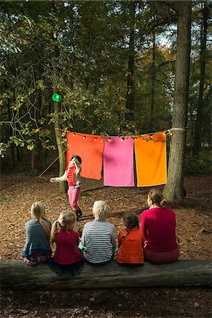 dangling - Childrens theater improvised in woods Stock Photo - Premium Royalty-Free, Code: 649-06489430