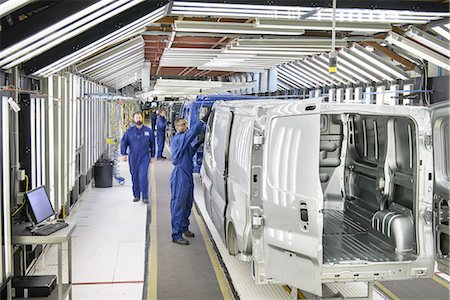 production - Workers inspecting cars in factory Stock Photo - Premium Royalty-Free, Code: 649-06489459