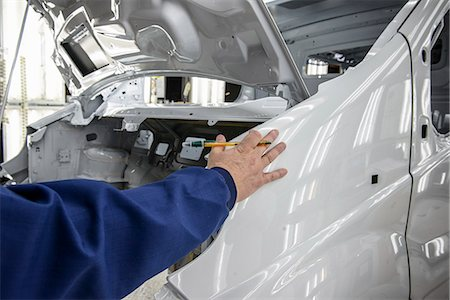 Worker inspecting car in factory Stock Photo - Premium Royalty-Free, Code: 649-06489450