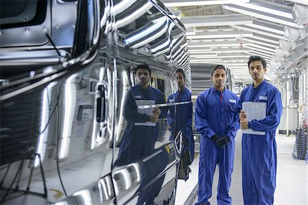 Workers standing in car factory Stock Photo - Premium Royalty-Free, Code: 649-06489453