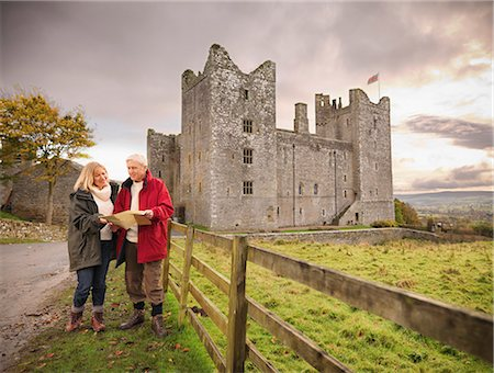 Older couple reading map by castle Stock Photo - Premium Royalty-Free, Code: 649-06489547