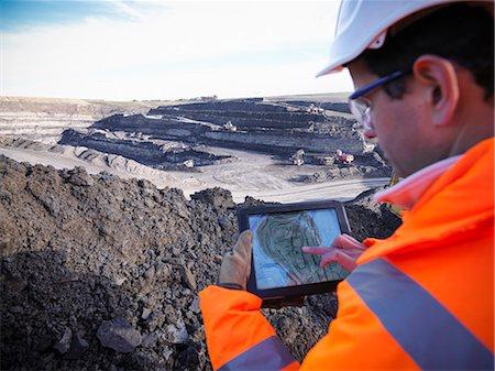 Ecologist examining surface coal mine Stock Photo - Premium Royalty-Free, Code: 649-06489574