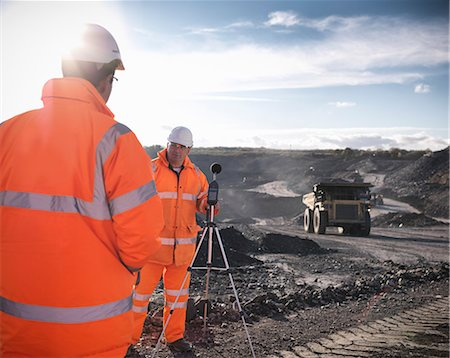 Ecologists listening to coal mine Stock Photo - Premium Royalty-Free, Code: 649-06489577