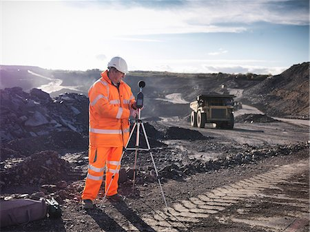 people working coal mines - Ecologist listening to coal mine Stock Photo - Premium Royalty-Free, Code: 649-06489578