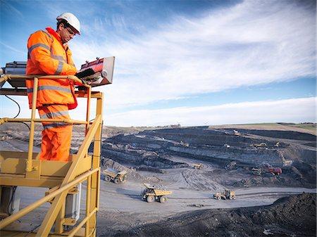 Ecologists examining coal mine site Stock Photo - Premium Royalty-Free, Code: 649-06489572
