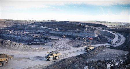 Trucks at surface coal mine site Stock Photo - Premium Royalty-Free, Code: 649-06489573