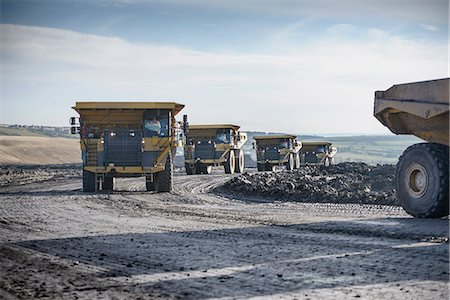 Trucks with coal rocks at surface mine Stock Photo - Premium Royalty-Free, Code: 649-06489606