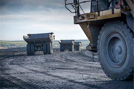 Trucks with coal rocks at surface mine Stock Photo - Premium Royalty-Free, Code: 649-06489609