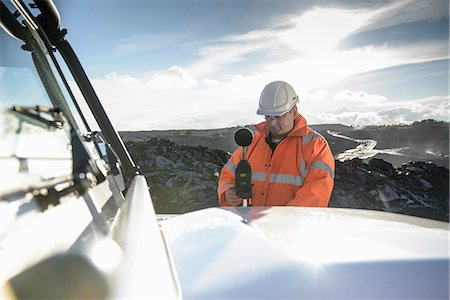 Worker using noise equipment on truck Stock Photo - Premium Royalty-Free, Code: 649-06489617