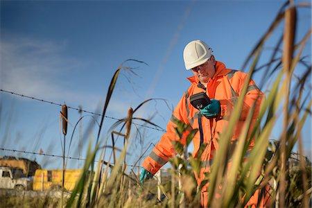 Worker monitoring water at coal mine Stock Photo - Premium Royalty-Free, Code: 649-06489618