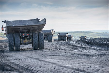 Trucks with coal rocks at surface mine Stock Photo - Premium Royalty-Free, Code: 649-06489610