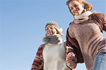 Smiling women running outdoors Stock Photo - Premium Royalty-Free, Code: 649-06489714