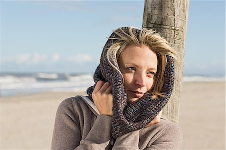 Woman wearing scarf on beach Stock Photo - Premium Royalty-Free, Code: 649-06489740