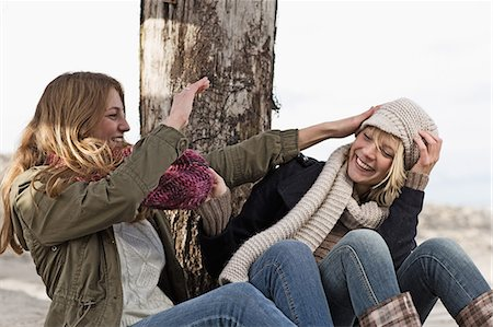 Smiling women playing on beach Stock Photo - Premium Royalty-Free, Code: 649-06489767