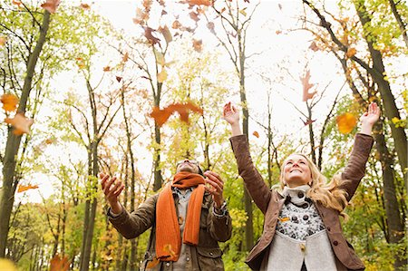 people falling - Smiling couple playing in autumn leaves Stock Photo - Premium Royalty-Free, Code: 649-06489798